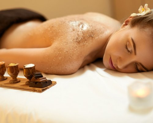 45743566 - body scrub. beautiful blonde gets a salt scrub beauty treatment in the spa salon